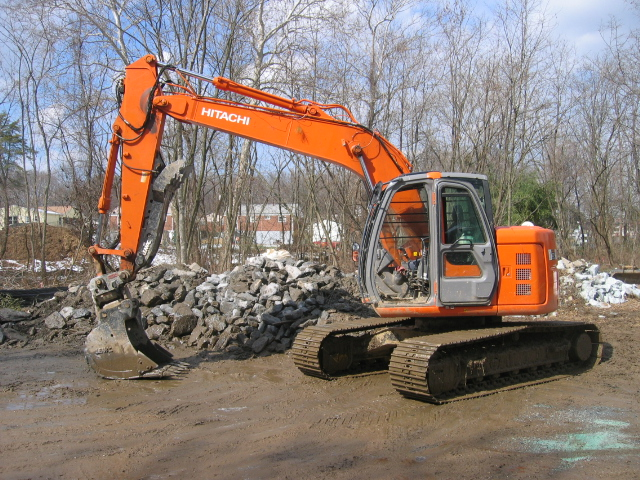 Image of an excavator at a construction site.