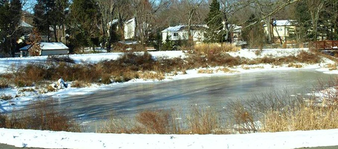 A stormwater pond with unsafe ice