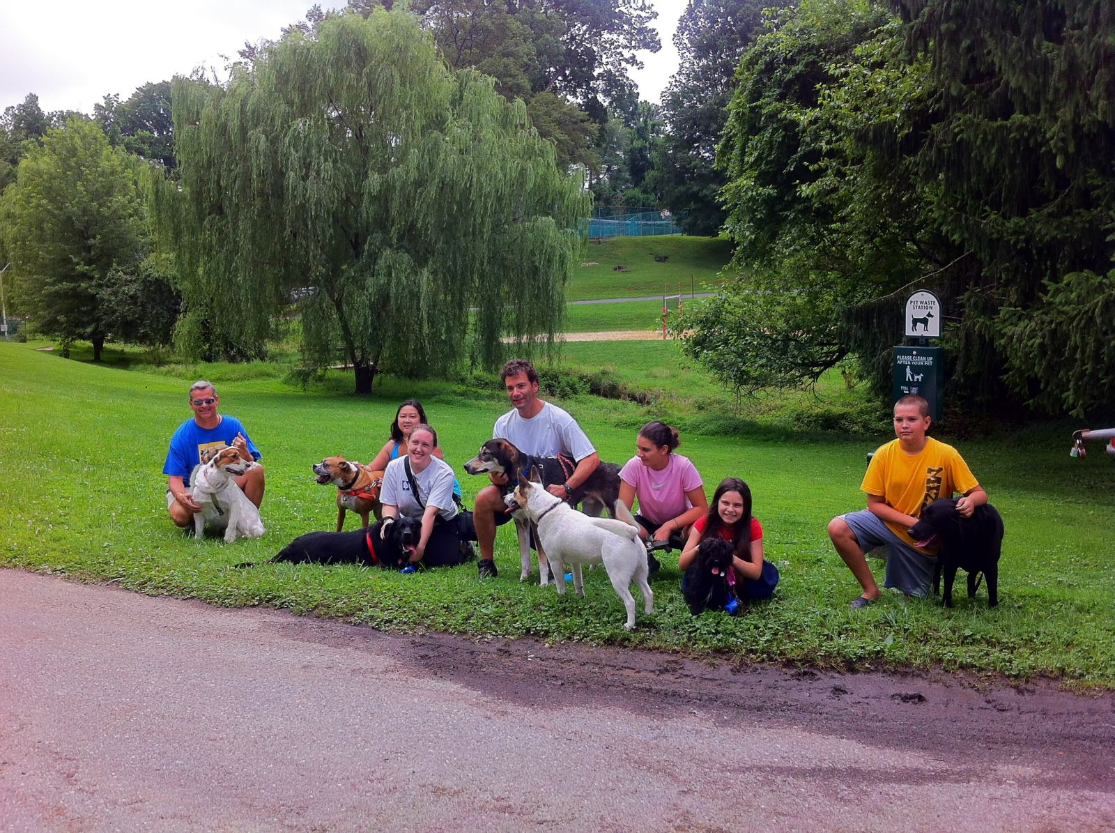 Image of dogs and their owners who participate in a pet waste station pilot.