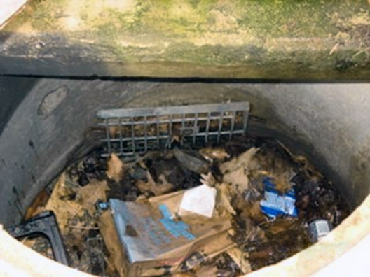 Image of flow splitter with debris and trash.