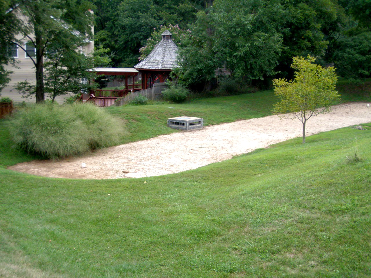 Image of a sand filter after cleaning. Vegetation was removed.