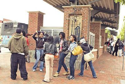 Picture of a group of people at the entrance of the Germantown Transit Center