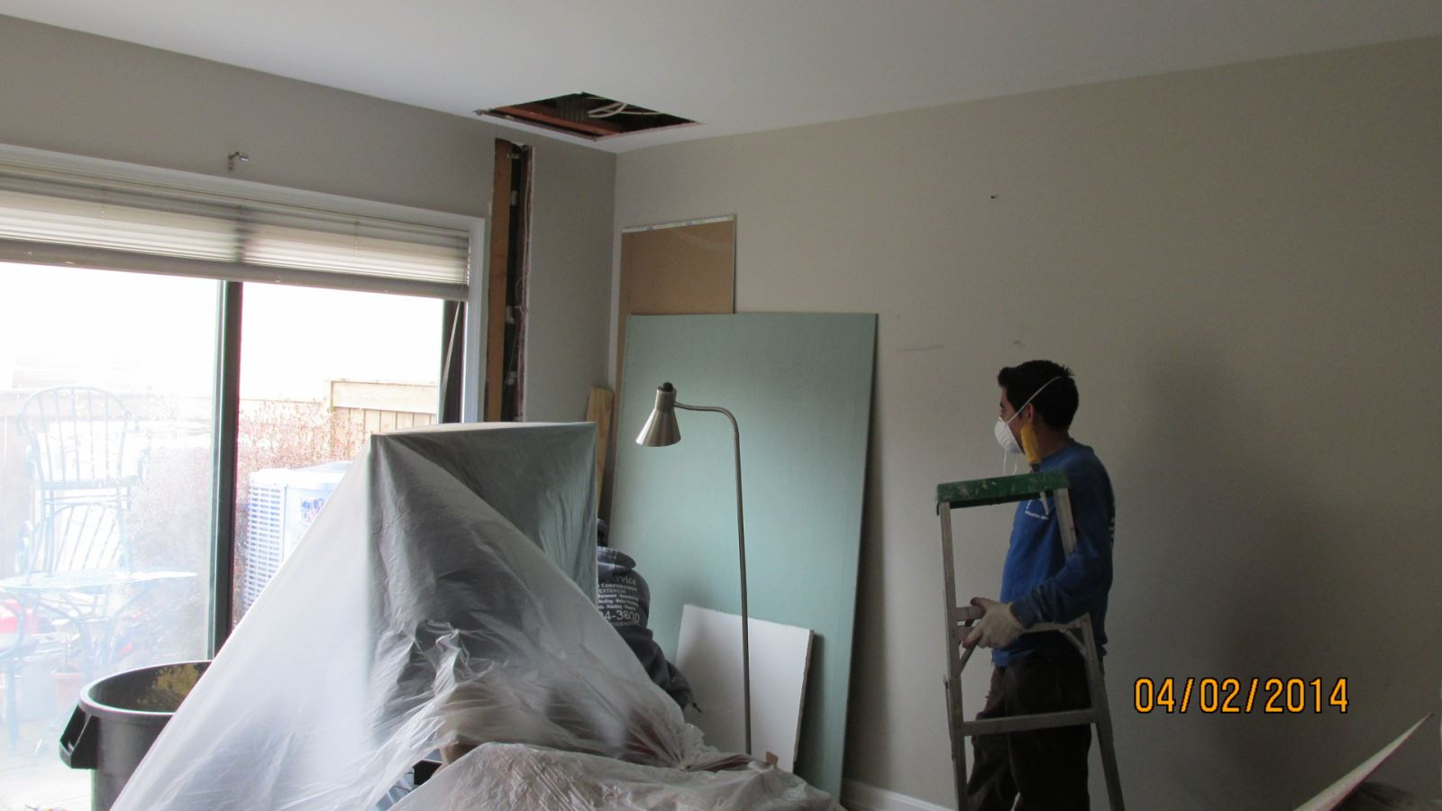 Workers installing heat pump