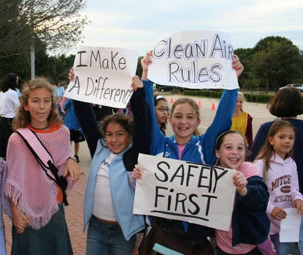 Elementary School Kids carrying safety signs