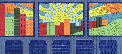 Mosaic of skyline with sun viewed through bus window.