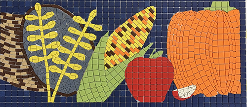 Mosaic of grain, corn, apple, and pumpkin.