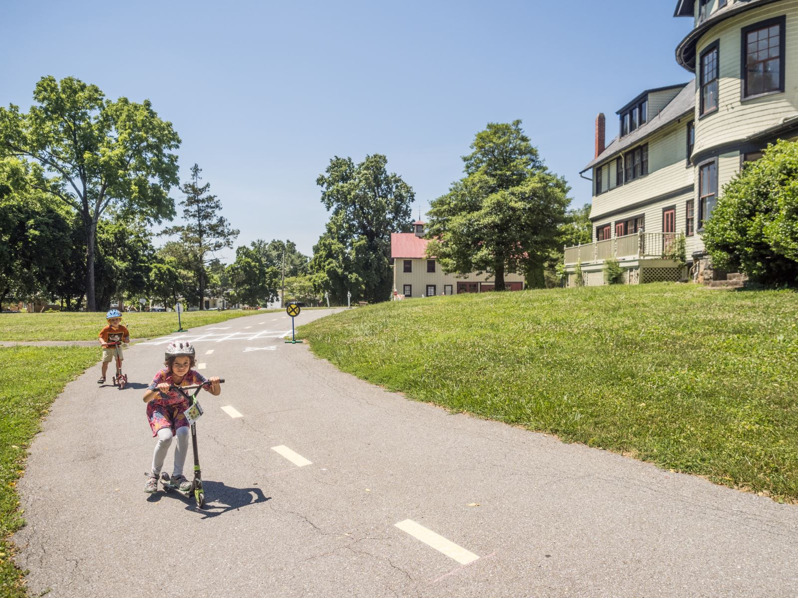 Children on scooters at the MCDOT traffic garden in Kensington