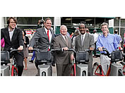 County Executive and others on bikeshare bikes