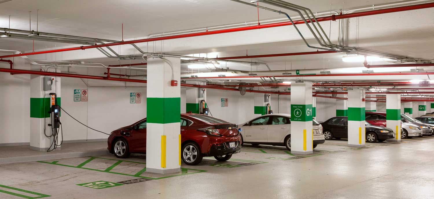 electric vehicle charging station in parking garage
