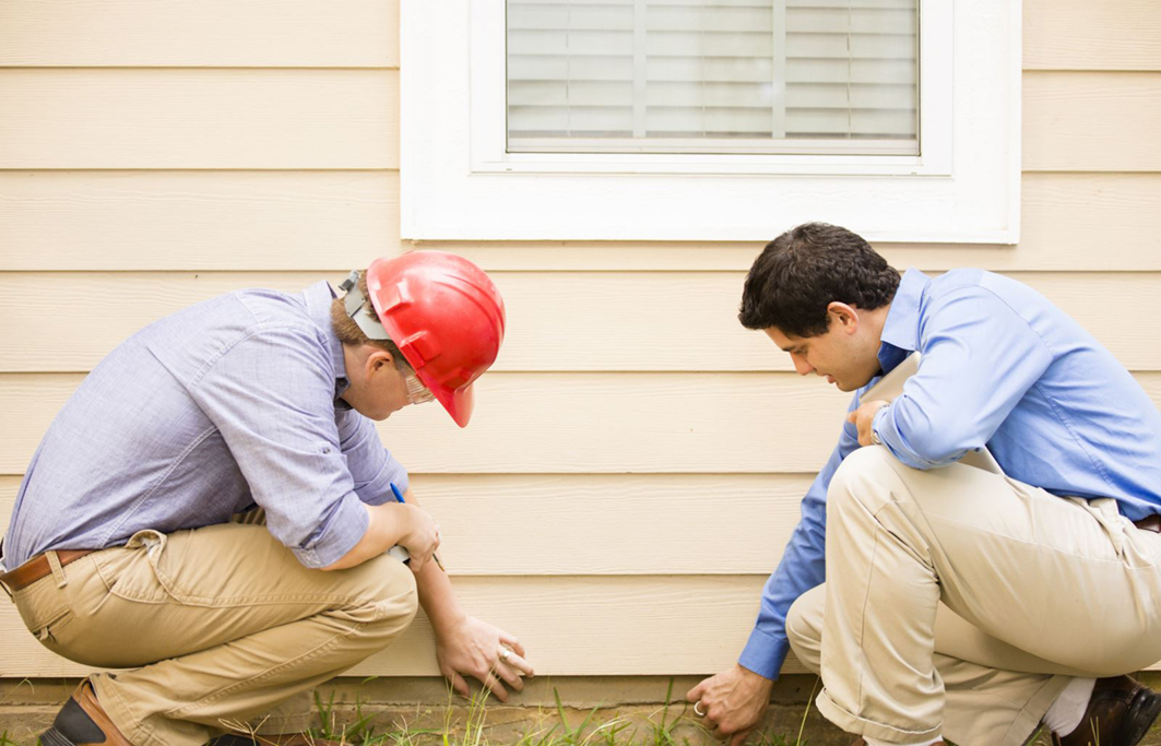 inspector and homeowner during an inspection