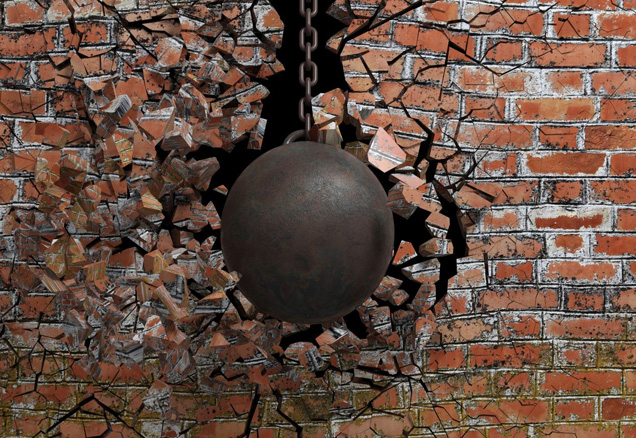 Wrecking ball smashing brick wall