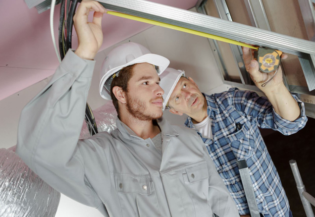 journeyman working with master electrician