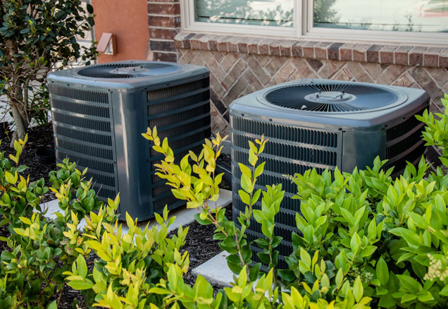 Two outside residential air conditioning units