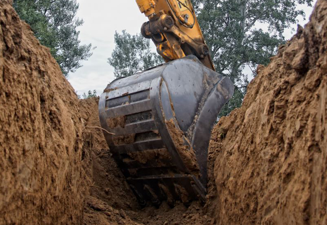Excavator truck digging a trench