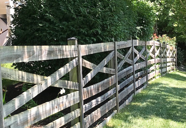 wooden fence in a yard of a single family home