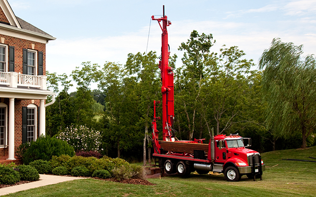 truck drilling a well for a single family house