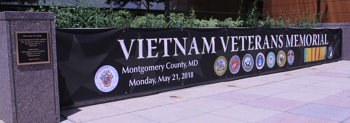 Honor and Gratitude Plaque for Vietnam Veterans Memorial and Wall of Fallen Heroes Names covered by a tarp