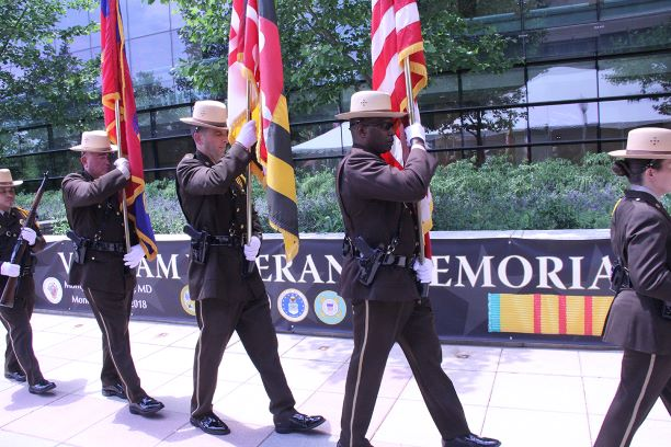Montgomery County Sheriffs Office Honor Guard walks past the Vietnam Veterans Memorial Wall