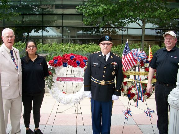 James Carter, Honor and Remember, a soldier, and Mission BBQ Staff with memorial wreaths