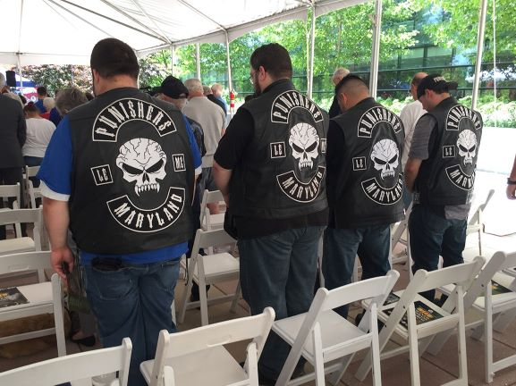 Motorcycle group Punishers Maryland bow their heads during the Vietnam Veterans Memorial Dedication ceremony