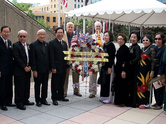 James Carter, Honor and Remember, with Hung (Tony), Manh Bui, Redducation Camp Survivor, and Representatives from the Vietnamese American Senior Association with wreath