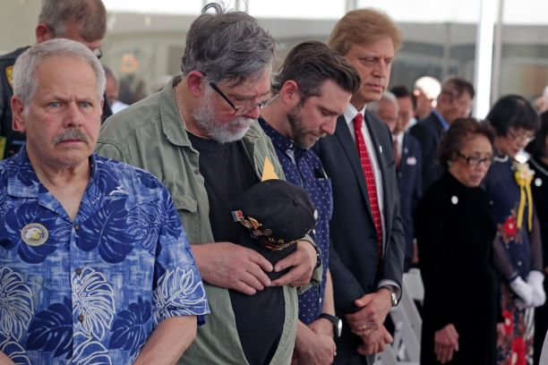Vietnam Veterans bow their head during benediction