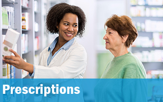 Pharmacist speaking to a women about prescriptions.