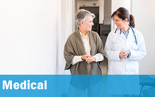 Mature individual walking and talking with her physician.