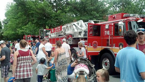 photo of people around fire truck