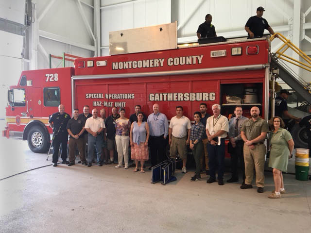 LEPC Members gathers before the Hazardous Materials Decontamination engine