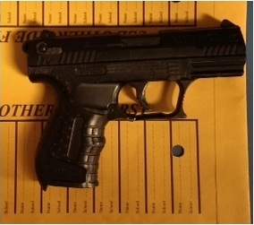 Bradshaw pointed this replica handgun at officers