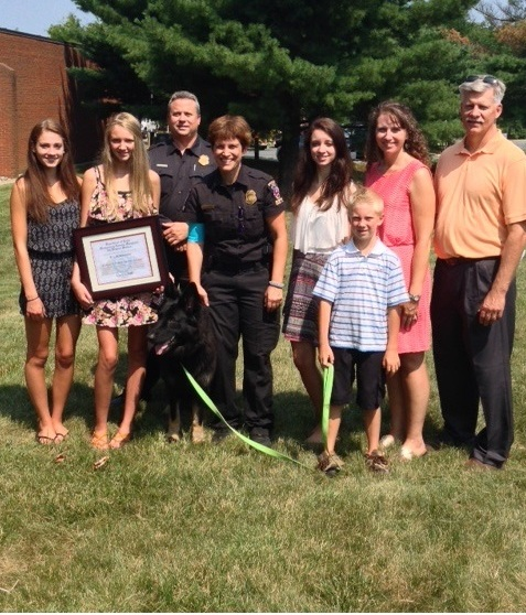 Eva, Commander David Gillespie, Officer Gamard, and Eva's family