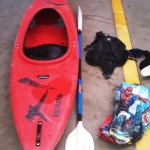 Red Kayak, Paddle, and other Items