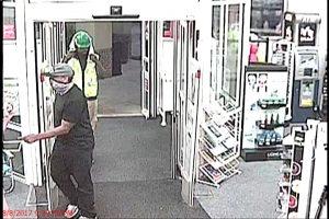 armed robber in black