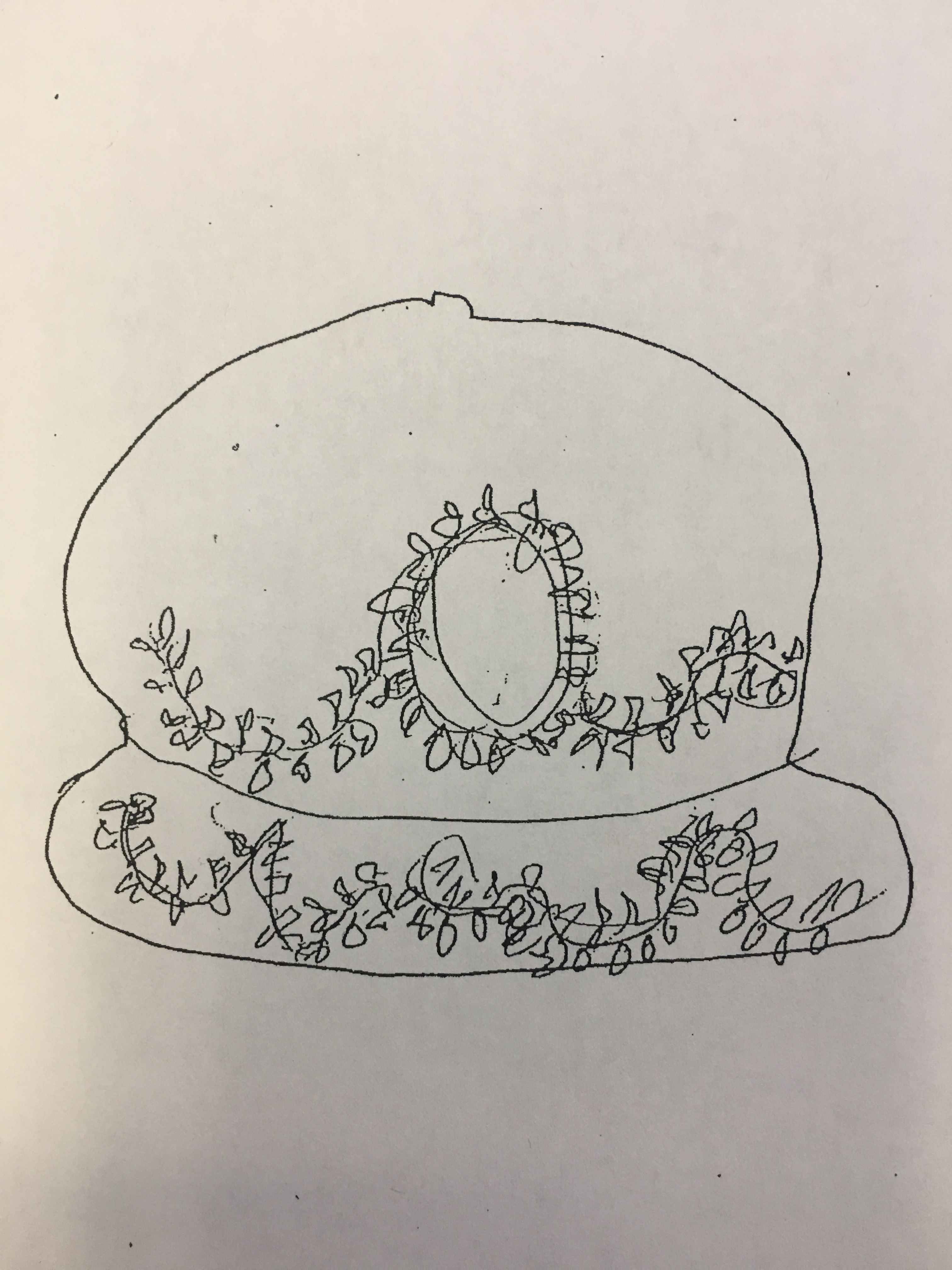 Sketch created by a victim of one of the sexual assaults that depicts a red baseball hat with white embroidered vines and leaves. The victim reported that the suspect wore this hat during the sexual assault.