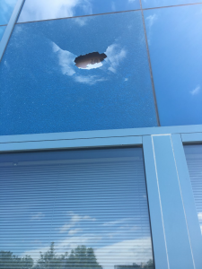 Vandalism to window at 3rd District Police Station