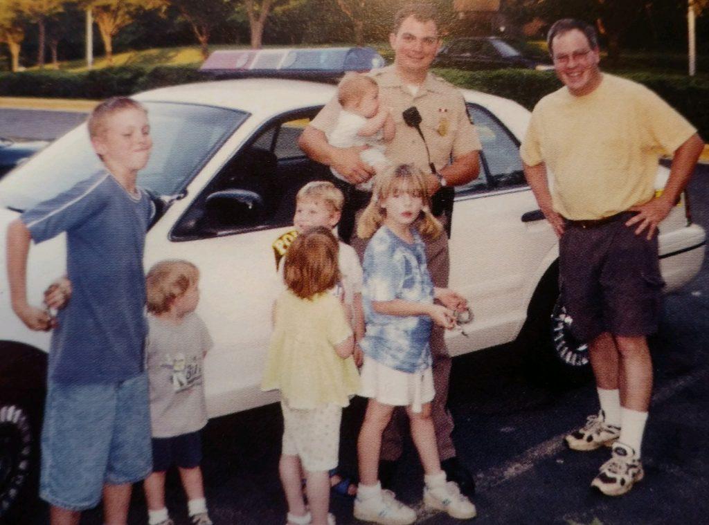 CIRCA 2000: Officer Robert Hunt holding young Thomas