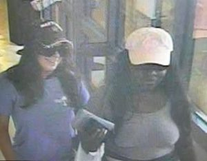 Suspects who used victim's stolen credit card following a residential burglary in North Potomac