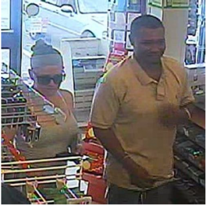 Suspect #1 and #2 who redeemed stolen Maryland Lottery tickets.
