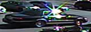Dark colored 2006 Mercury Grand Marquis that suspects may be operating.