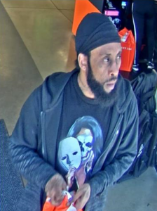 Original surveillance photograph of suspect which was released to media and public on May 15.