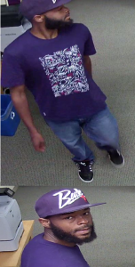 Suspect who forced entry into an office work area in Bethesda and stole a credit card from an unattended purse.
