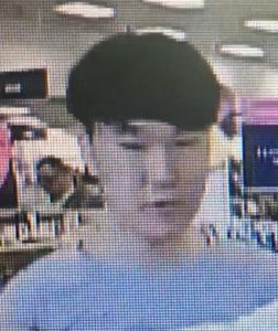 suspect who took photographs underneath an adult female's dress while she shopped inside a department store in Rockville.