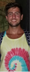 Updated photograph of Alexander Fadi Ashy who was last seen wearing this tie dye shirt in the Inner Harbor area of the city of Baltimore on Sunday, July 15, 2018.
