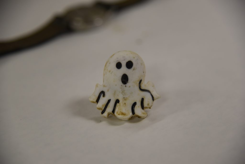 Photograph of front of ring that was found with the decedent.
