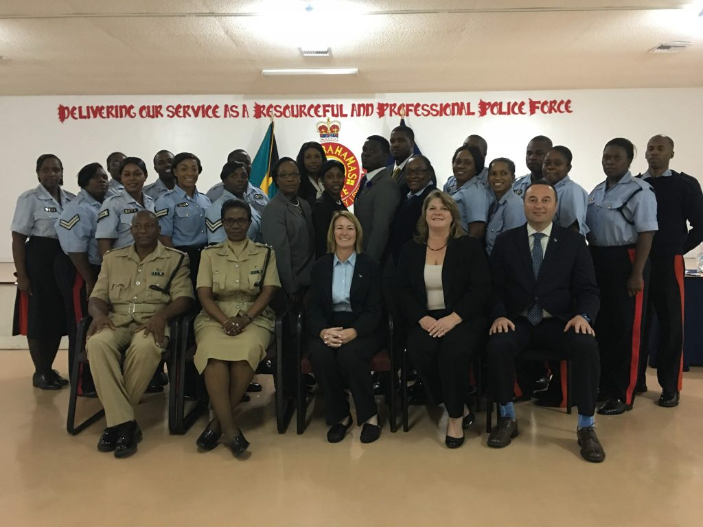 Royal Bahamas Police Force officers and MCP officers during training. { Front row, third chair: Lieutenant Sheila Sugrue / Front row, fourth chair: Detective Deana Mackie / Front row, fifth chair: Detective Randy Kucsan}