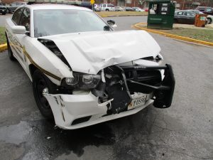 MCP cruiser damaged during pursuit of stolen GMC Yukon driven by Salgado-Umana