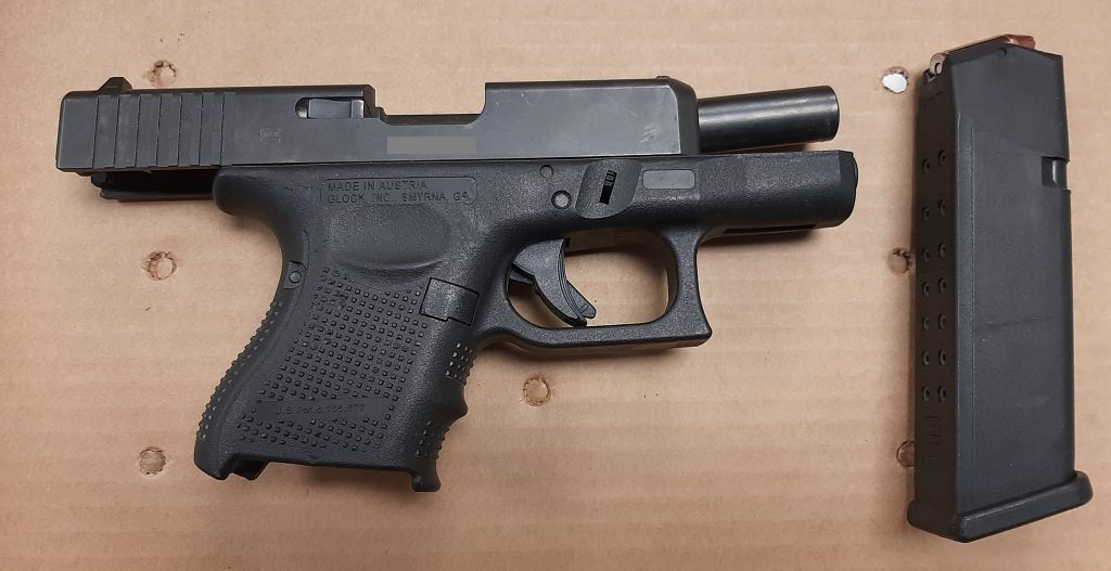 Gun recovered in Evans' suitcase
