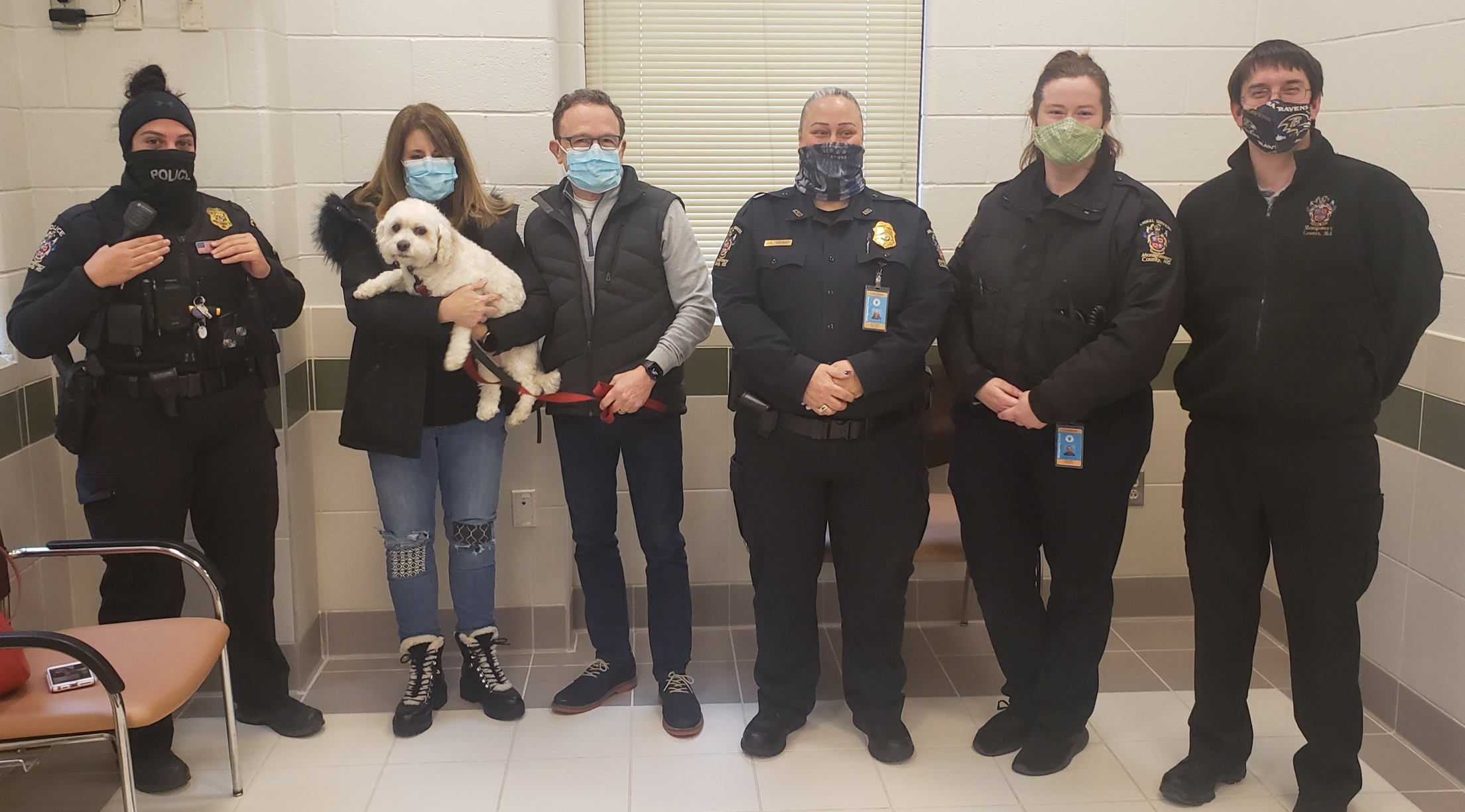 (L to R) Officer C. De Sousa - one of the responding officers to adoption center, Two owners, Animal Services Field Supervisor Jeanette Wright, Animal Services Officer Sarah Ogrin - stalled the suspect until police arrived, Animal Services Customer Service Representative William Eisenbarth - recognized the stolen dog