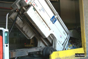 Truck unloading recyclables